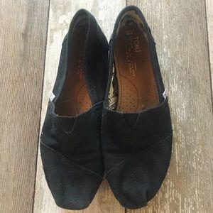 Women's black slip on toms